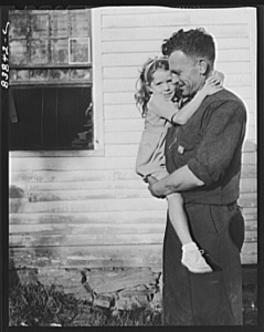 Norwich, Connecticut (vicinity). Swedish farmer who also works in defense plant to pay off debt on farm. He has just arrived home from the factory, and in a few minutes will be doing odd chores around the farm. (Photographer: John Collier) Source: http://photogrammar.yale.edu/records/index.php?record=fsa2000054888/PP